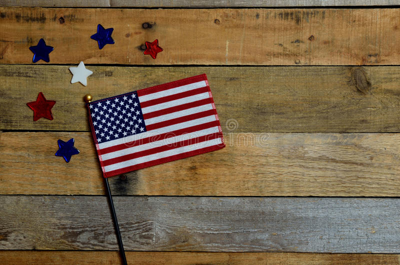 American Flag with red, white and blue stars. Set on pallet wood royalty free stock images