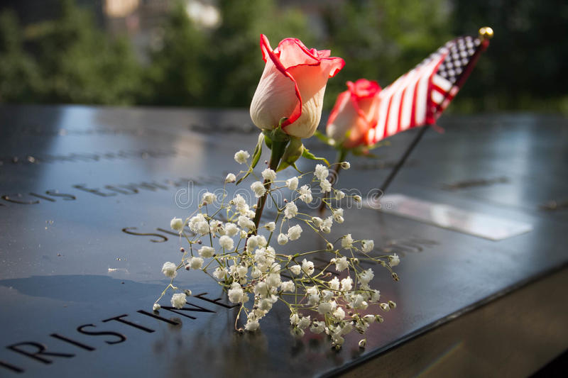 American flag, rose and flower at the 911 memorial world trade center royalty free stock photos