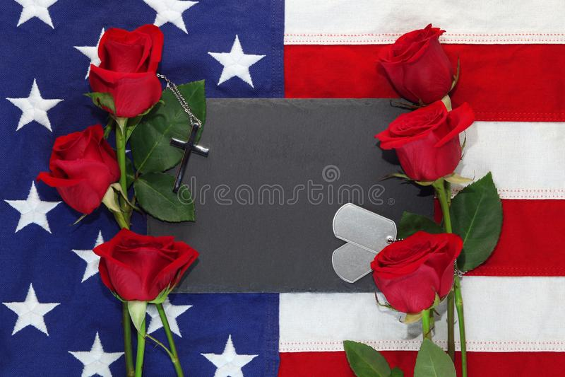 American flag with roses and military dog tags stock photography