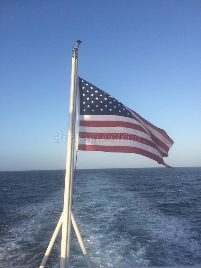 American Flag at Sea stock images