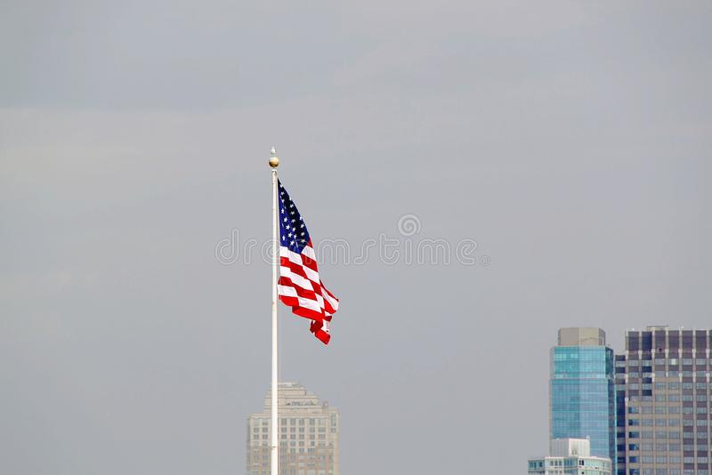 American flag on sky background. Beautiful landscape backgrounds stock images