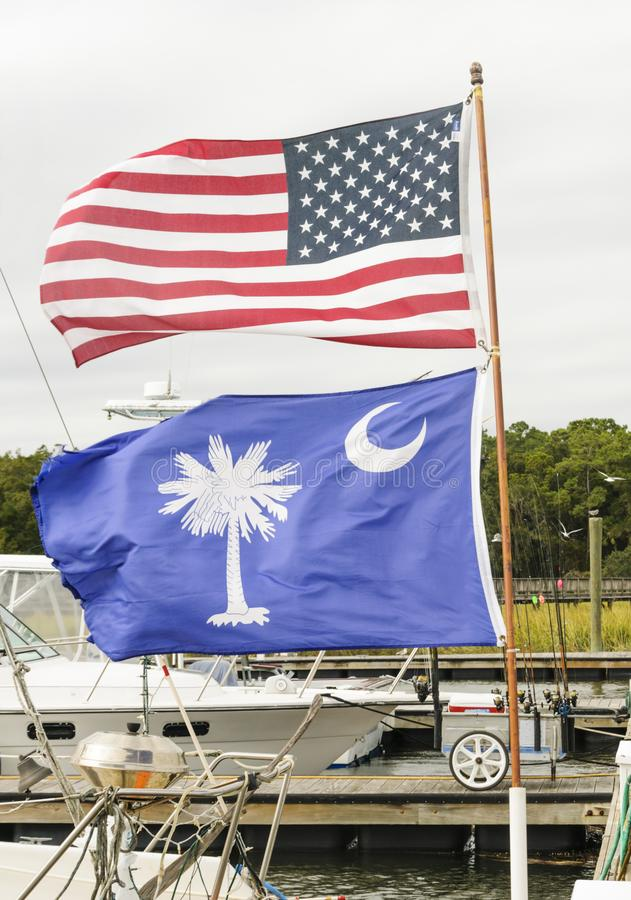 American Flag and South Carolina Flag flying together in dock area at Hilton Head Island. American Flag and South Carolina Flag flying together in dock area stock photos