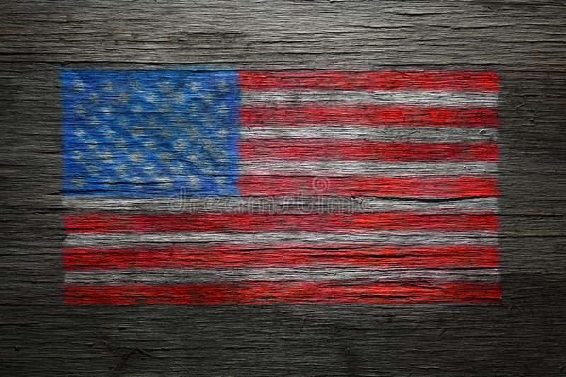 American flag spray painted on old wood royalty free stock images