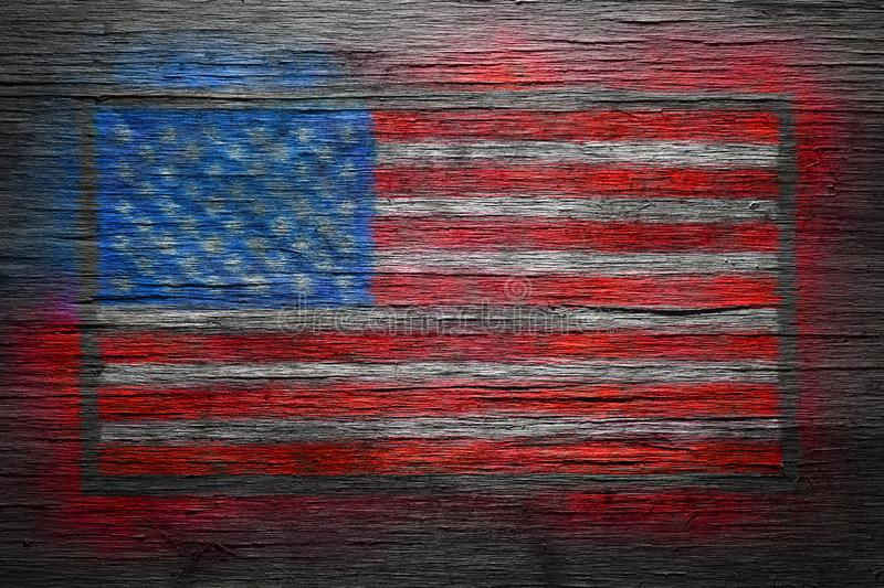 American flag spray painted on old wood royalty free stock photography