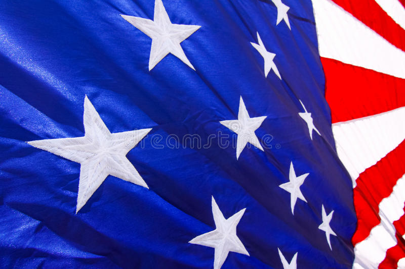 American Flag Stars & Stripes Red, White & Blue. A close up view of the bright white stars stitched into the brilliant blue background of a colorful American stock photography