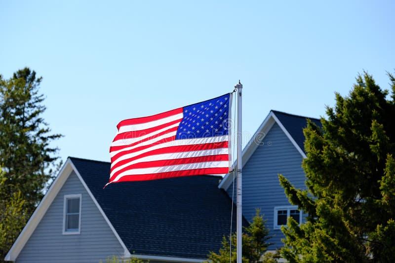 American flag. At suburban neighborhood stock photo