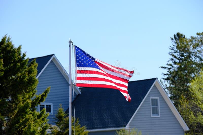 American flag. At suburban neighborhood stock image