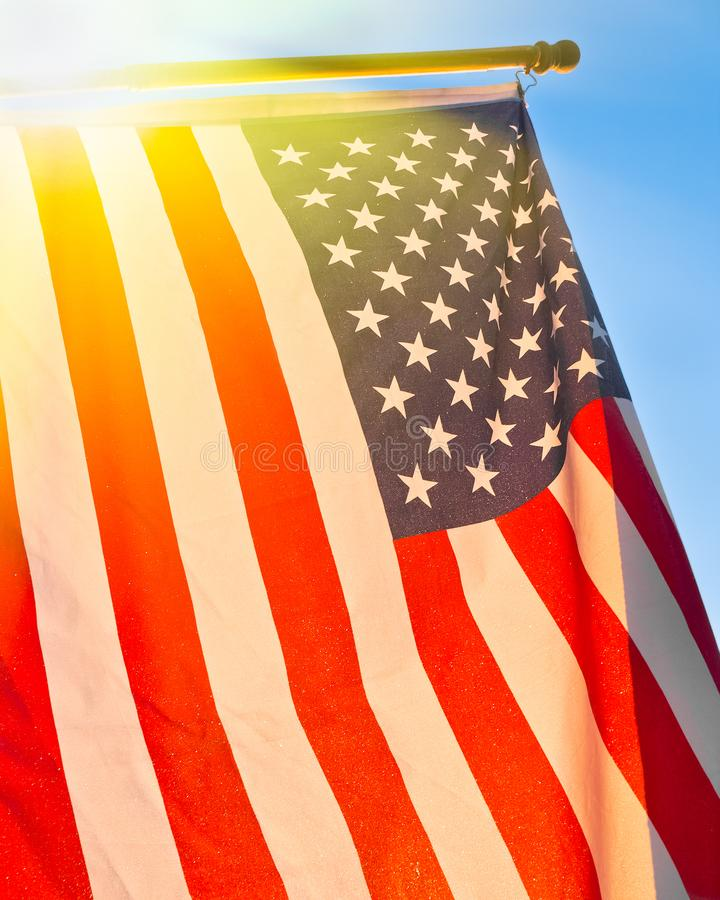American Flag. With sun flare royalty free stock image