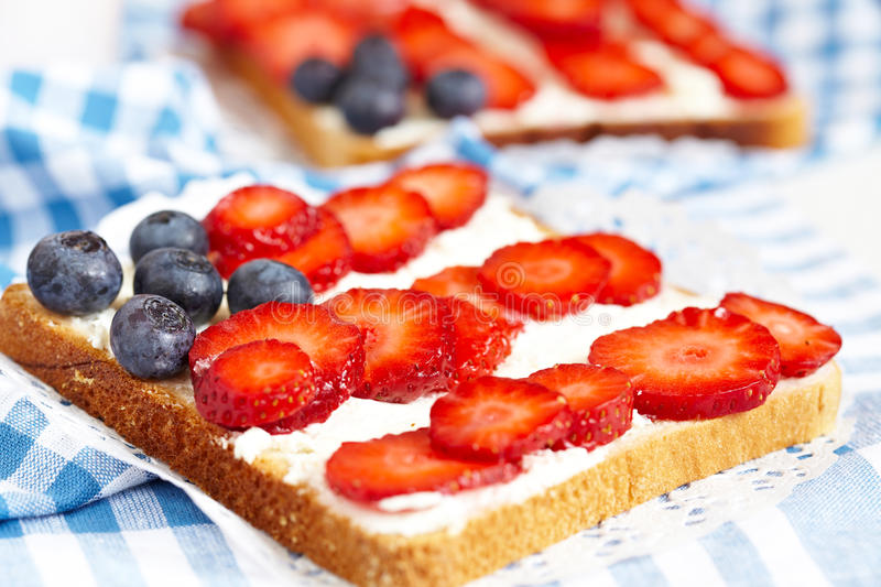 American flag toast. With cream cheese, strawberry and blueberry stock photography