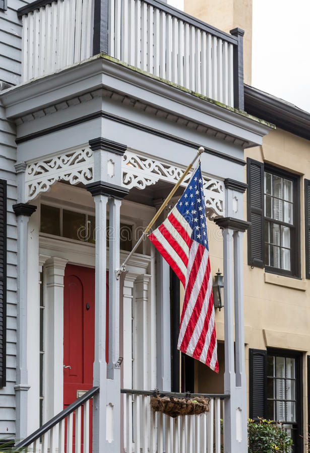 American Flag on Traditional Porch stock photography