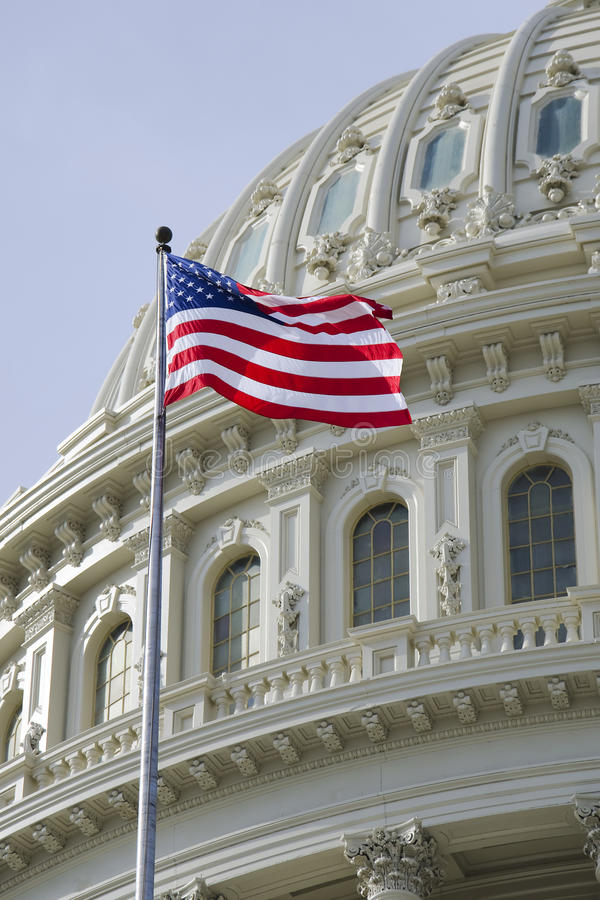 American flag with US Capitol dome detail royalty free stock photo