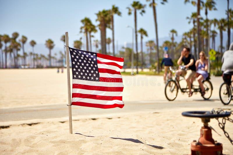 American Flag on Venice Beach. American Flag waving on Venice Beach California stock images