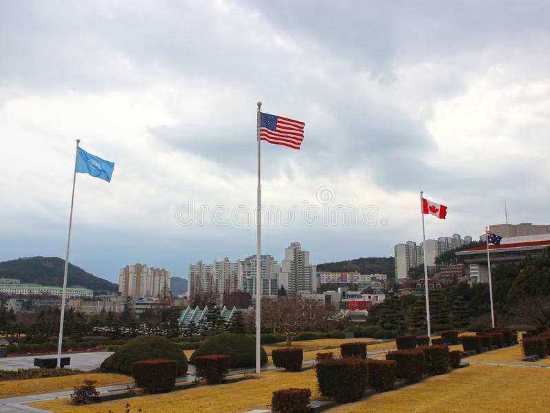 American Flag Waving in the air of UN Memorial Cemetery in Busan, South Korea, Asia royalty free stock photos