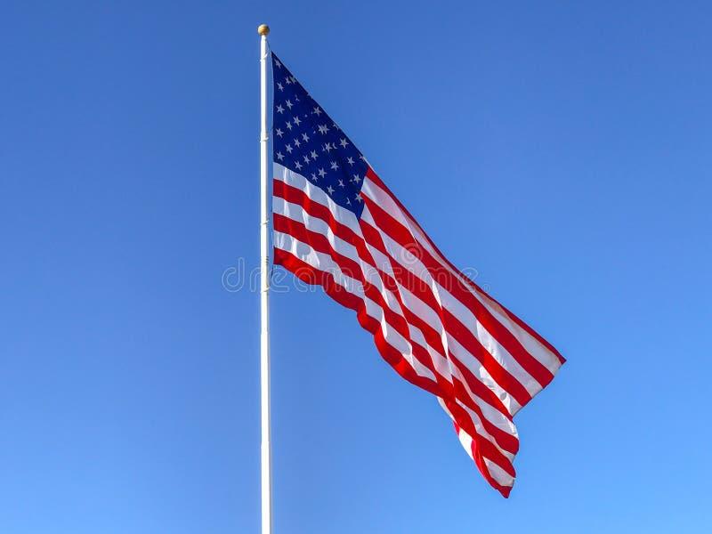 American flag waving. American flag waving in blue sky stock photos