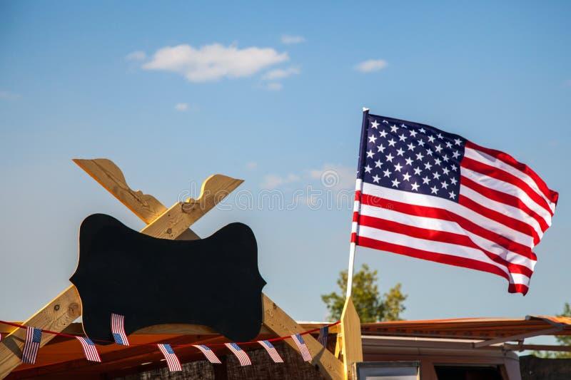American flag waving on blue sky background stock photos