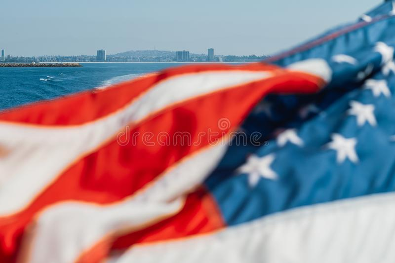American Flag Waving over the Ocean. royalty free stock image