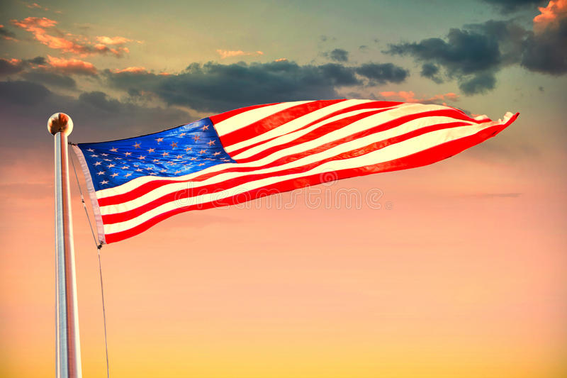 Composite image of american flag waving over white background royalty free stock photo