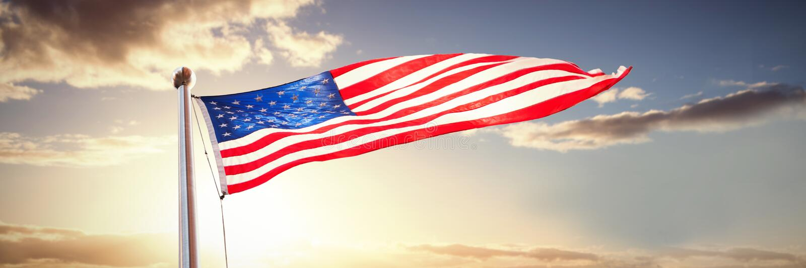 Composite image of american flag waving over white background. American flag waving over white background against panoramic view of golden fields royalty free stock photography