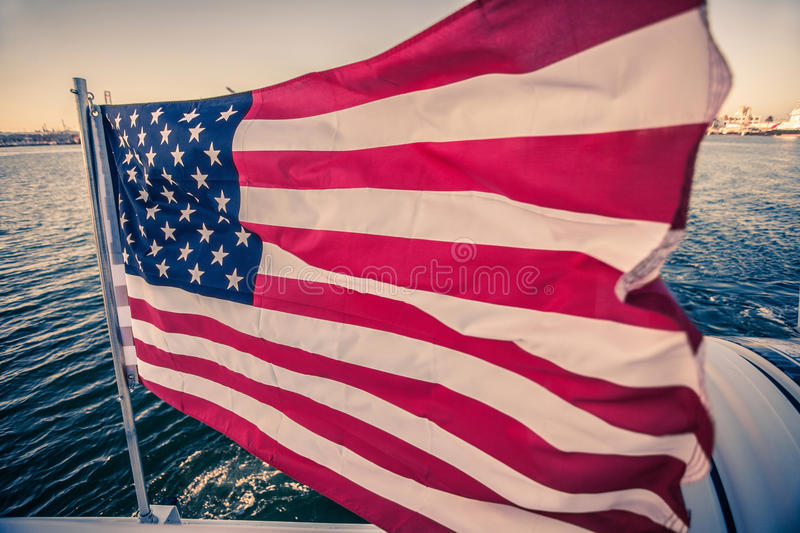 American flag waving on a rapid moving boat royalty free stock photography