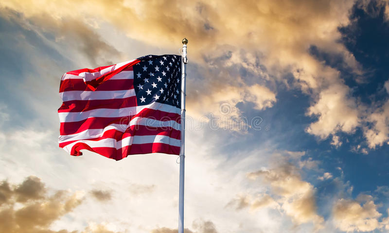 American flag waving. In the sky royalty free stock photo