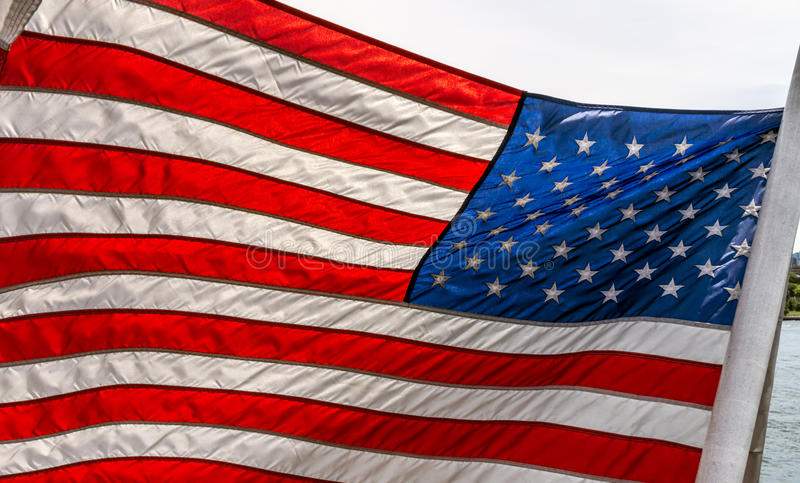 American Flag. Waving in the wind royalty free stock photography