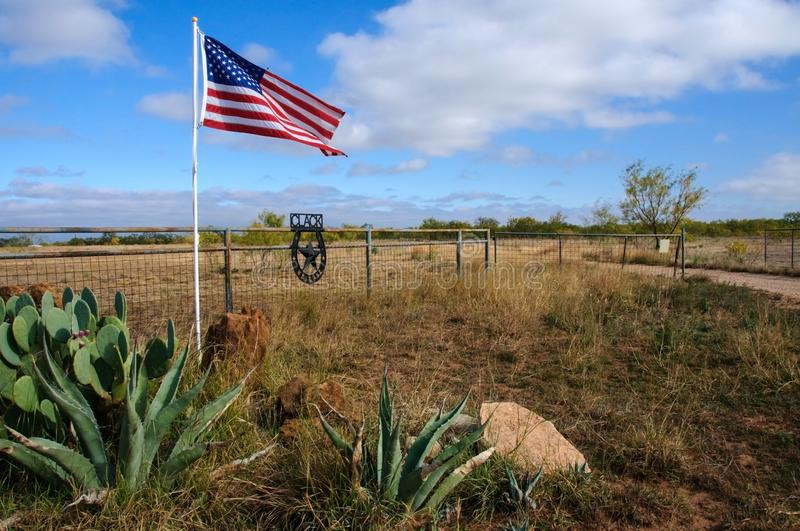 American flag waving in the wind against a background of wildlife, cacti and agave in Texas, USA royalty free stock photography