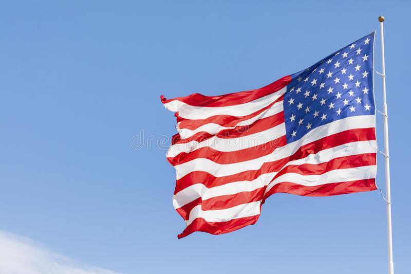 American flag waving in the wind stock images