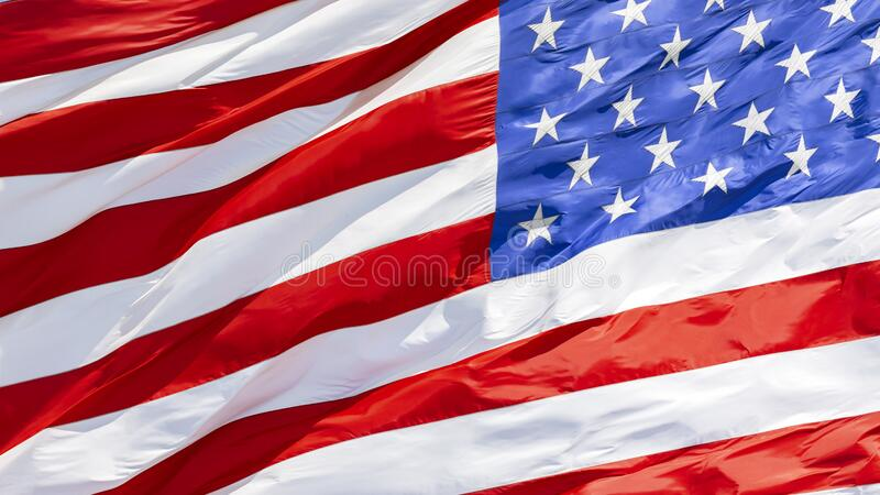 American flag waving in the wind royalty free stock photography