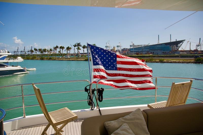 American Flag Waving on Yacht in Miami, Florida. American flag waving in the wind on a luxury yacht in Miami, Florida stock photo