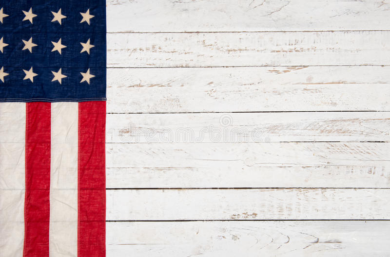 American flag. White wooden background with an American flag stock images