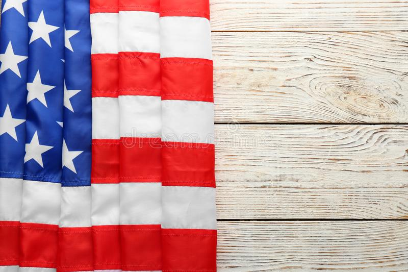 American flag on white wooden background, top view royalty free stock images