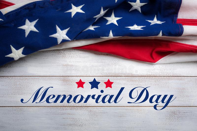 American flag on a white worn wooden background with memorial day greeting. United states flag on white, weathered clapboard background with memorial day stock photography