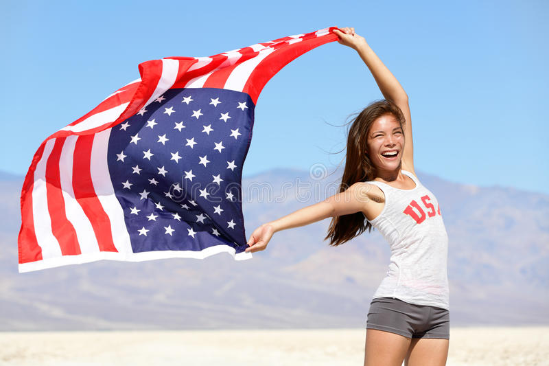 American flag - woman USA sport athlete winner. Cheering waving stars and stripes outdoor after in desert nature. Beautiful cheering happy young multicultural royalty free stock photography