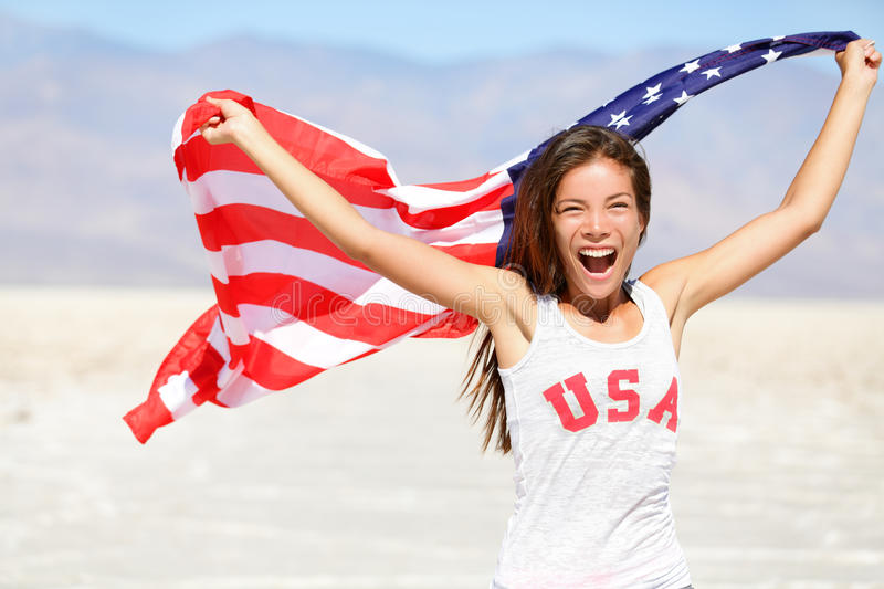 American flag - woman USA sport athlete winner. Cheering waving US flag Stars and Stripes outdoor running in nature. Beautiful cheering happy young stock images