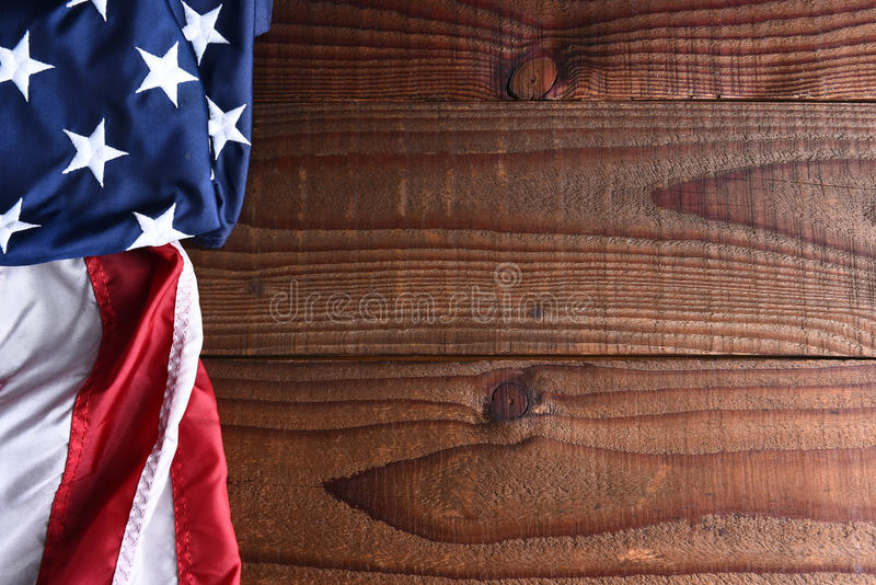 American Flag on Wood. Closeup of an American flag on a dark wood table with copy space stock photography