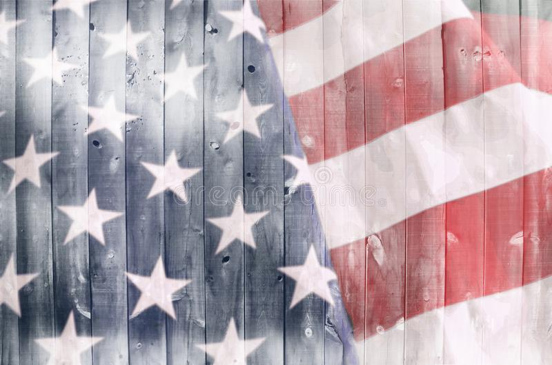 American Flag on Wood. A wood surface with an American flag image inside of it royalty free stock image