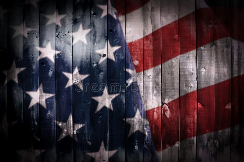 American Flag on Wood. A wood surface with an American flag image inside of it royalty free stock photo