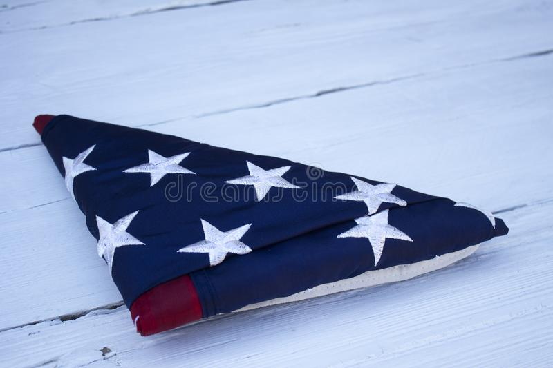 American flag on a wooden background for Memorial Day and other holidays of the United States of America. royalty free stock images