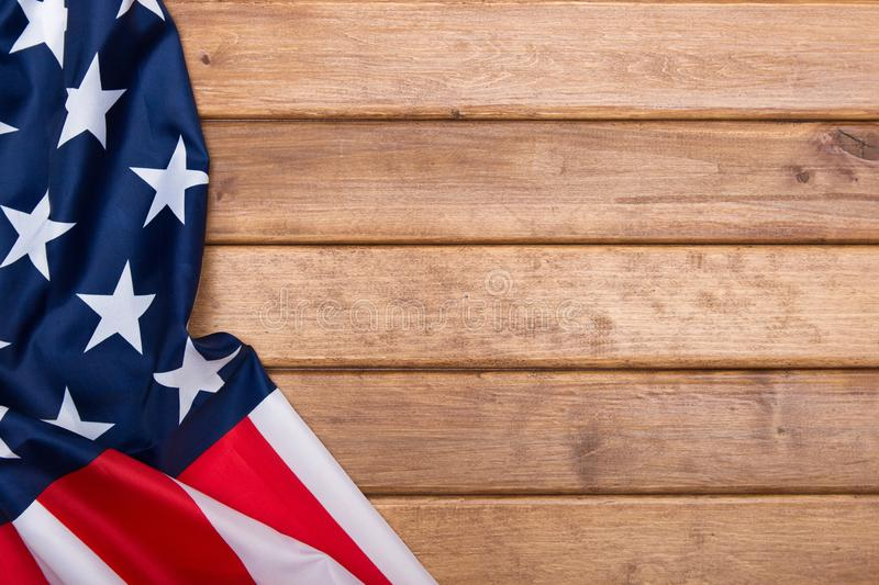 American flag on wooden background with a toning effect.The Flag Of The United States Of America. Template.The view from the top.  royalty free stock image