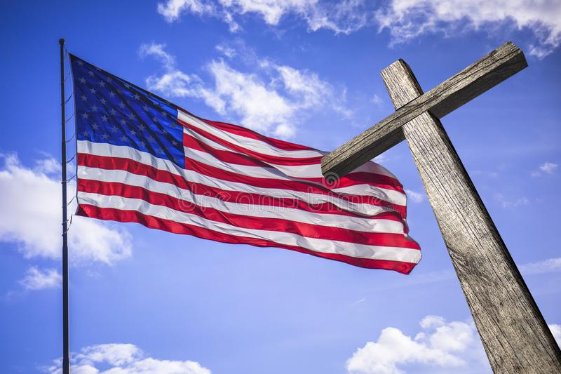 American flag with a wooden cross. Symbol of the blessed American nation royalty free stock image
