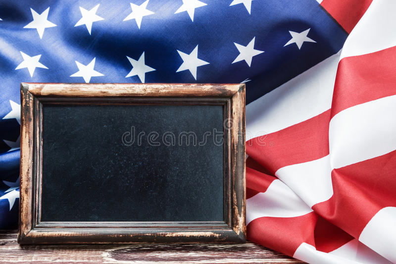 American flag on a wooden table and a blackboard stock images