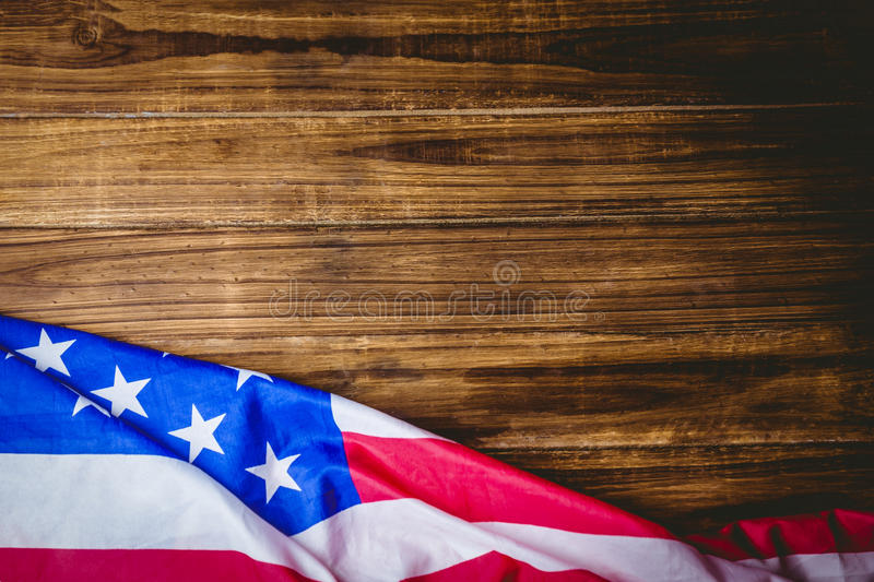American flag on wooden table. Shot in studio stock photo