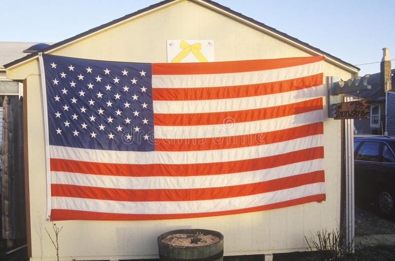 American Flag and Yellow Ribbon Hung on Shed stock image