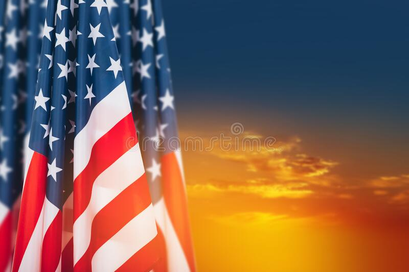 American flags against beautiful sky at sunset.  Perfect background for Memorial day, Independence Day and Veterans Day.  American stock photo