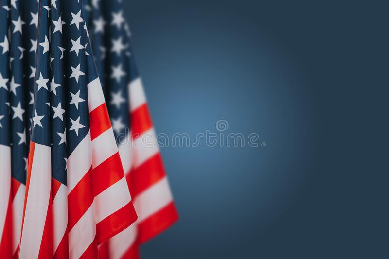 American flags on blue background. Perfect image for Memorial day, Independence Day and Veterans Day.  American patriotism concept stock images