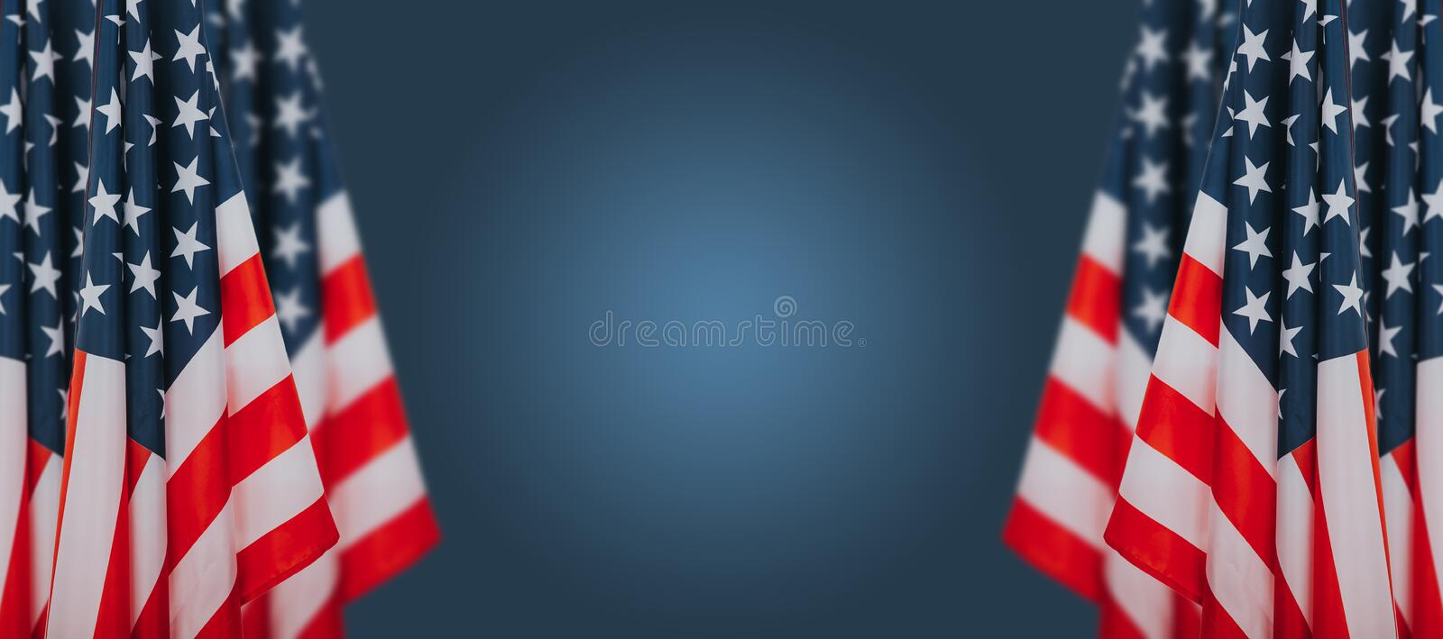 American flags on blue background. Perfect image for Memorial day, Independence Day and Veterans Day.  American patriotism concept stock image