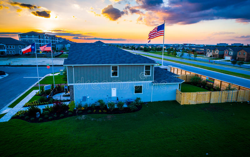 American Flags with New development Suburb and Texas Flag at Sunset stock photos