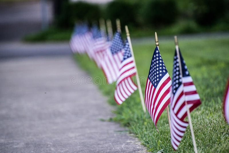 American Flags. By sidewalk vanishing point royalty free stock photo