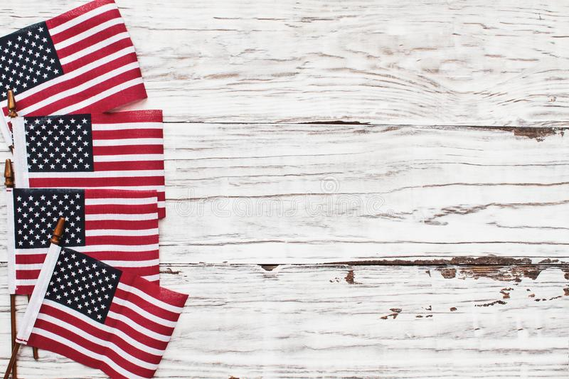 American Flags for the 4th of July Celebration against a White Rustic Background. American Flags for the America`s 4th of July Celebration over a white rustic stock image