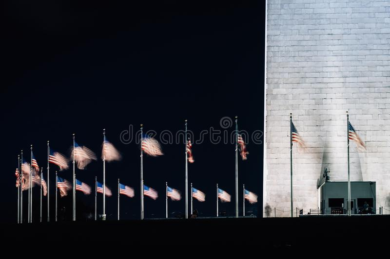 American flags and Washington Monument at night, in Washington, DC.  stock image